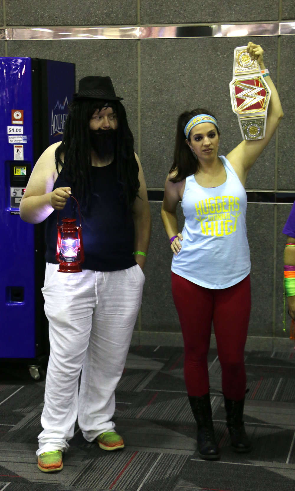 Bray Wyatt, left, and Bayley cosplayers pose in the lobby.