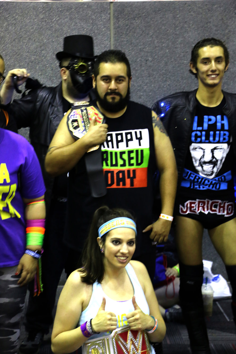 Cosplayers of Marty Scurll, from left, Rusev, Bayley and Chris Jericho.