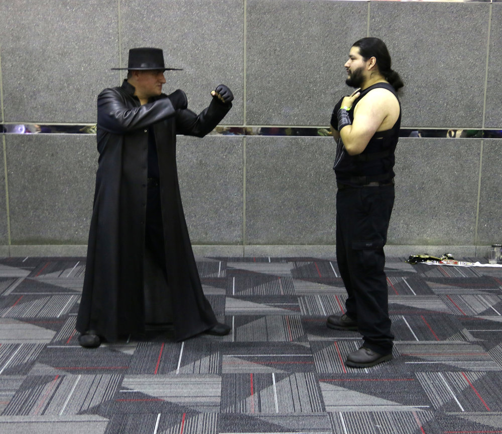 WrestleMania rematch: Undertaker, left, against Roman Reigns.