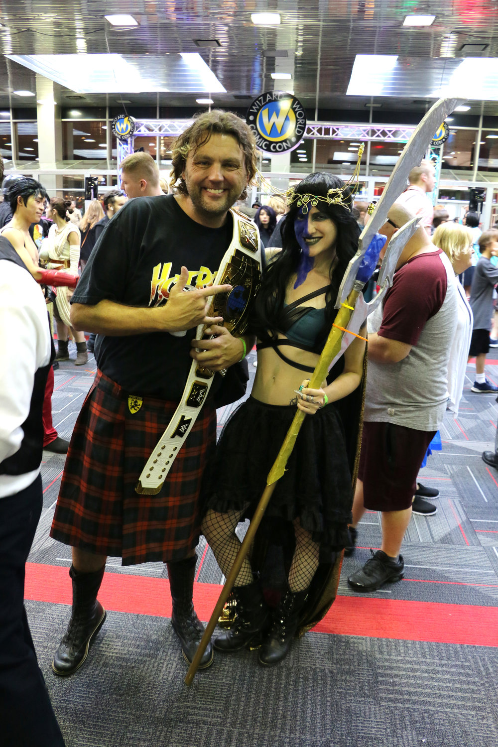 Independent wrestlers Joey Roth (as Rowdy Roddy Piper) and Roxi Heart (as Lady Loki) pose in the lobby at Wizard World Chicago 2018.