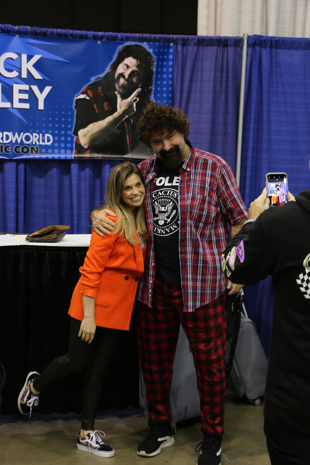 "Danielle Fishel, who played Topanga Lawrence on TV's ""Boy Meets World,"" poses with WWE Hall of Famer Mick Foley at Wizard World Chicago on Friday, August 24, 2018.  (Photo by Mike Pankow)"
