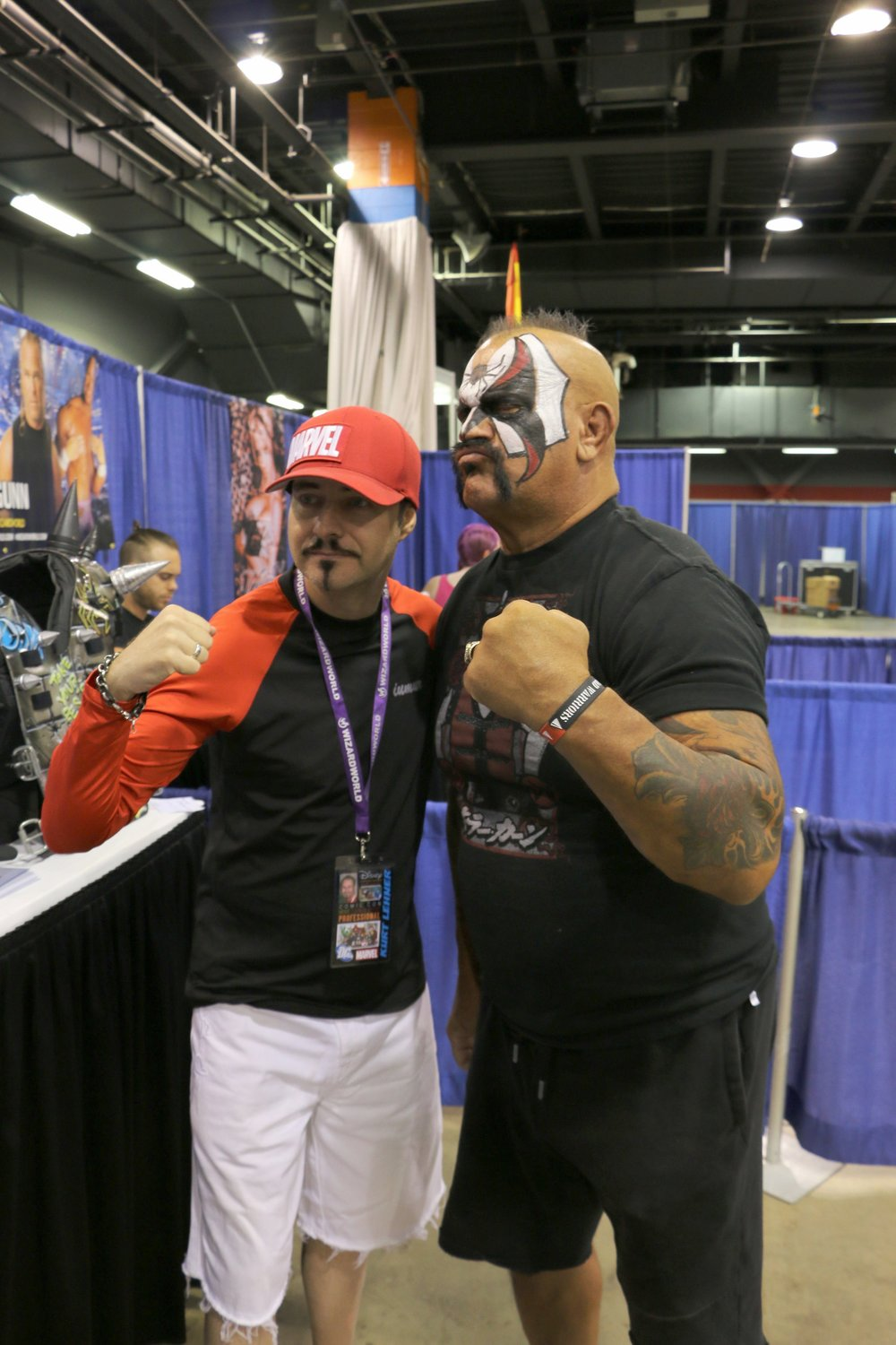Famous artist and illustrator Kurt Lehner, left, who has worked for companies such as Marvel, Walt Disney Studios and DreamWorks, poses with legendary wrestler Road Warrior Animal at Wizard World Chicago at Donald E. Stephens Convention Center on Friday, August 24, 2018.  (Photo by Mike Pankow)