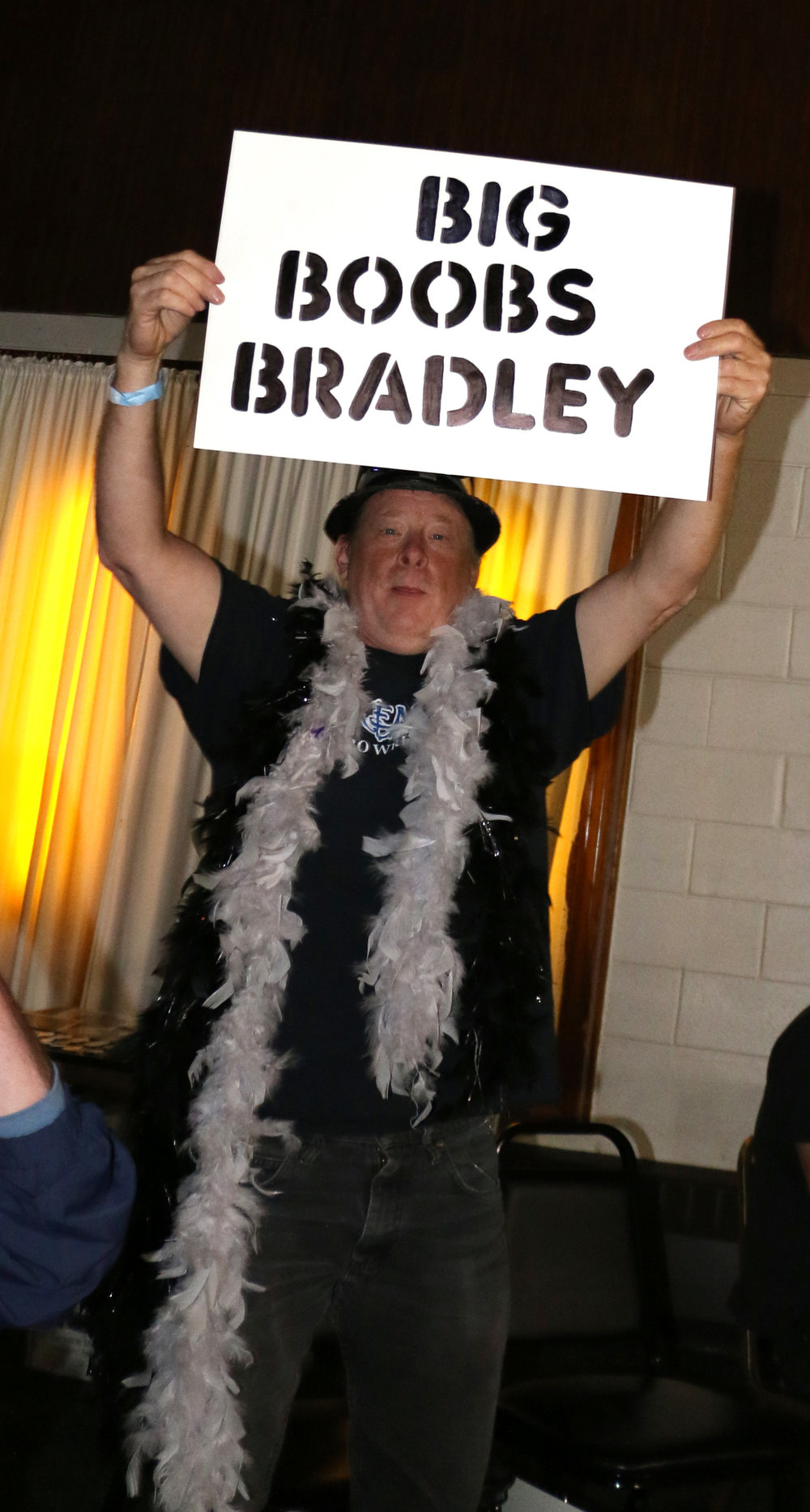 A fan mocks Jay Bradley with his sign.