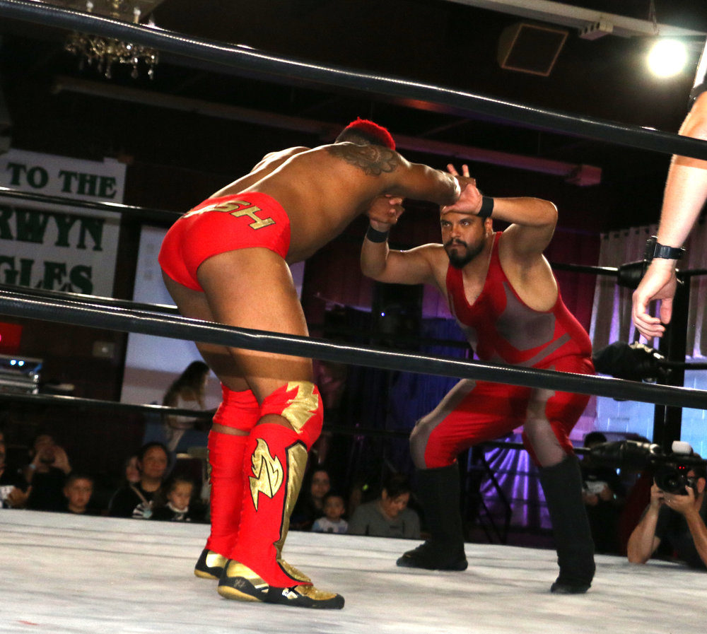"Roy ""Flash"" Gordon, left, squares off with Ernesto Aguilar during an eight-man tag team match."