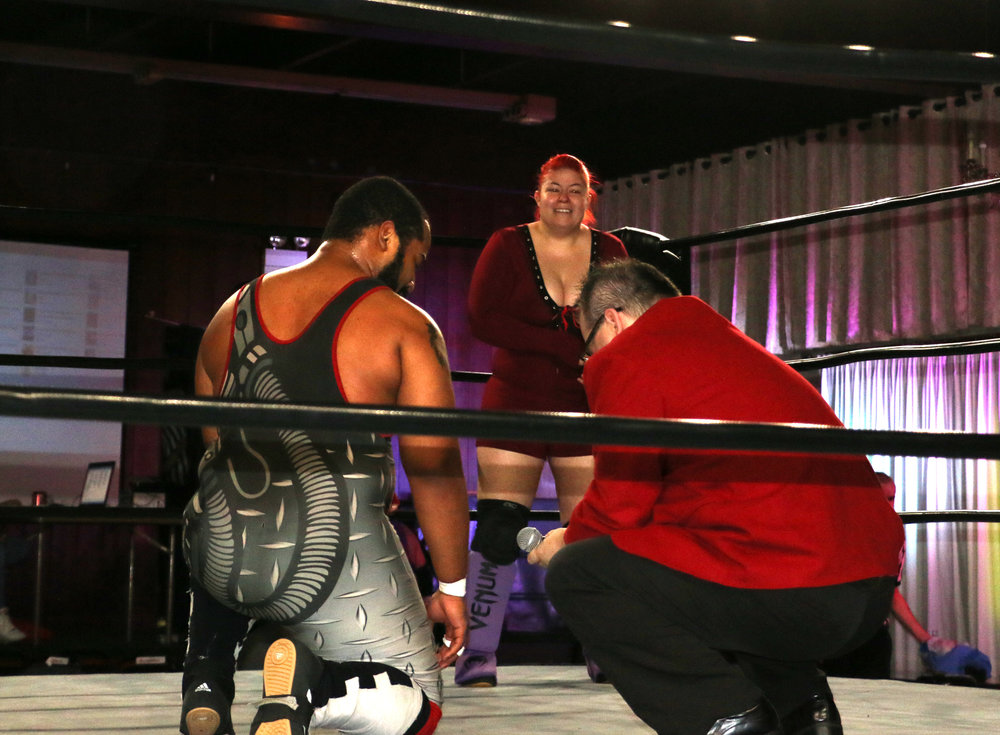 Mike Strong proposes to his girlfriend, Vega Venum, as BCW Commissioner Frankie Rodriguez assists.