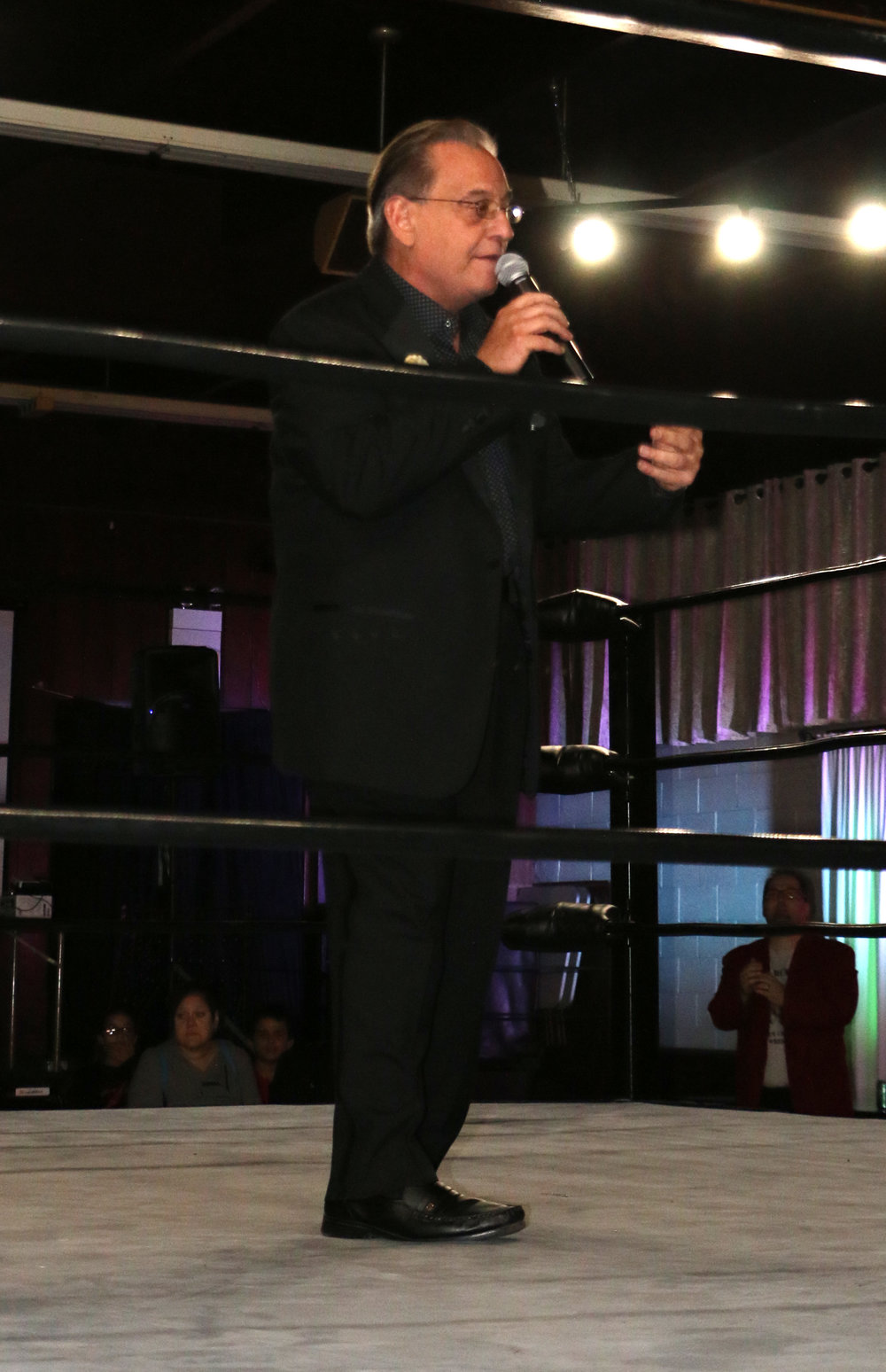Legendary ring announcer Gary Michael Cappetta gets ready to introduce the competitors for the Jay Bradley-Steve Michaels match.