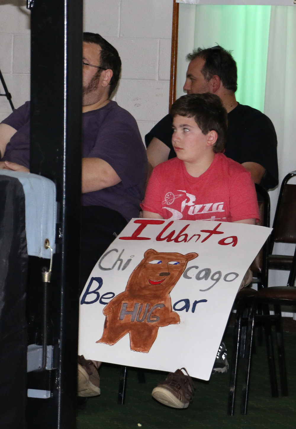 A young fan holds a Steve Michaels sign.