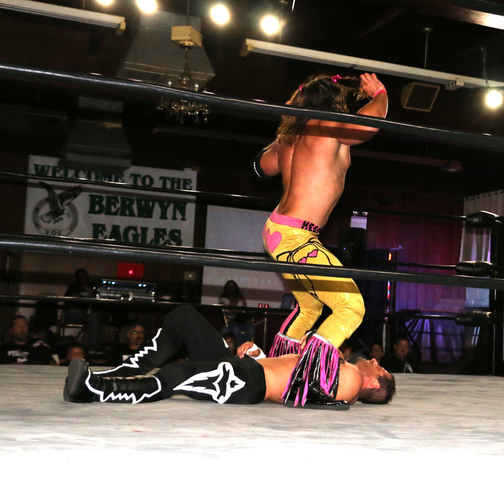 Jaden Roller dances above Vic Capri during their BCW Championship match.