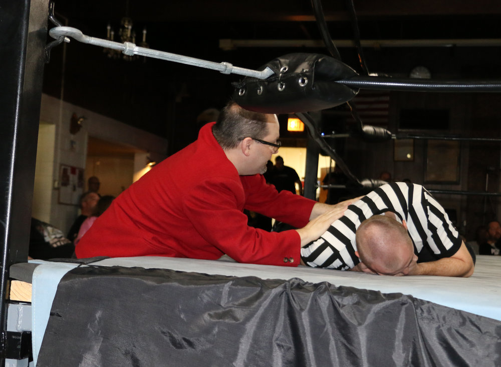 BCW Commissioner Frankie Rodriguez checks on the referee, who took a blow during the Jaden Roller-Vic Capri bout.