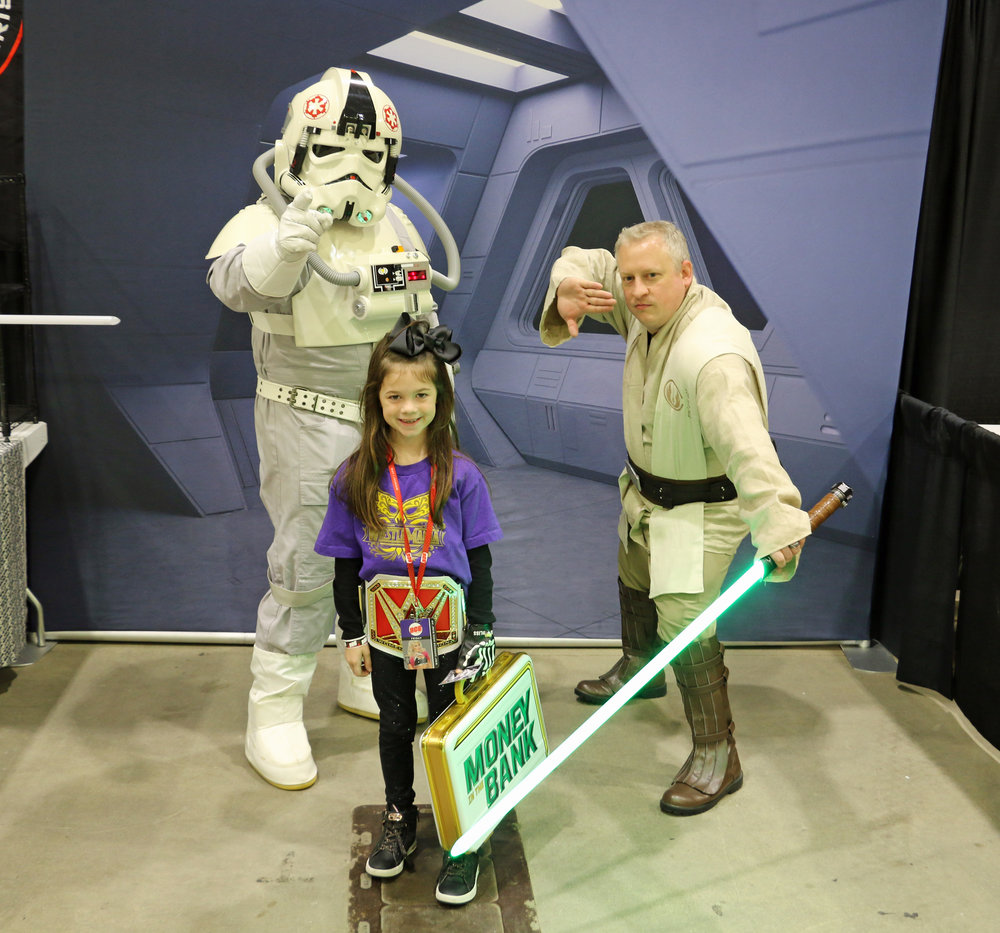 A young WWE fan poses with members of the Star Wars' 501st Legion Midwest Garrison.