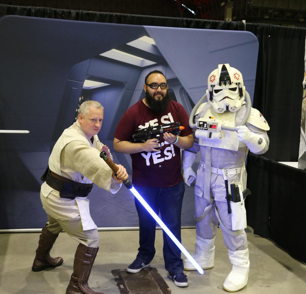 A WWE fan poses with members of the Star Wars' 501st Legion Midwest Garrison.