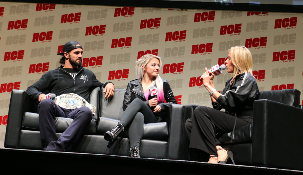 Lilian Garcia, right, moderated a panel with Seth Rollins, left, and Alexa Bliss.
