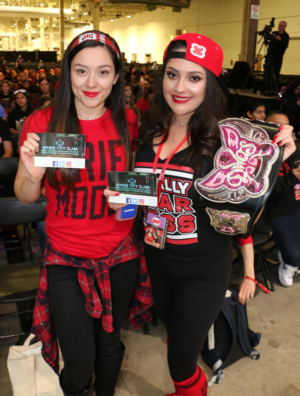 Fans of the Bella Twins pose before Nikki and Brie appeared for their WWE panel.