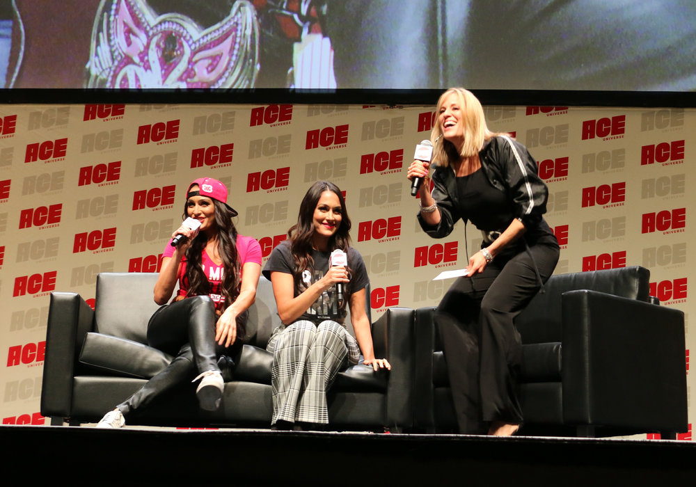 Former WWE ring announcer Lilian Garcia, right, introduces the Bella Twins.
