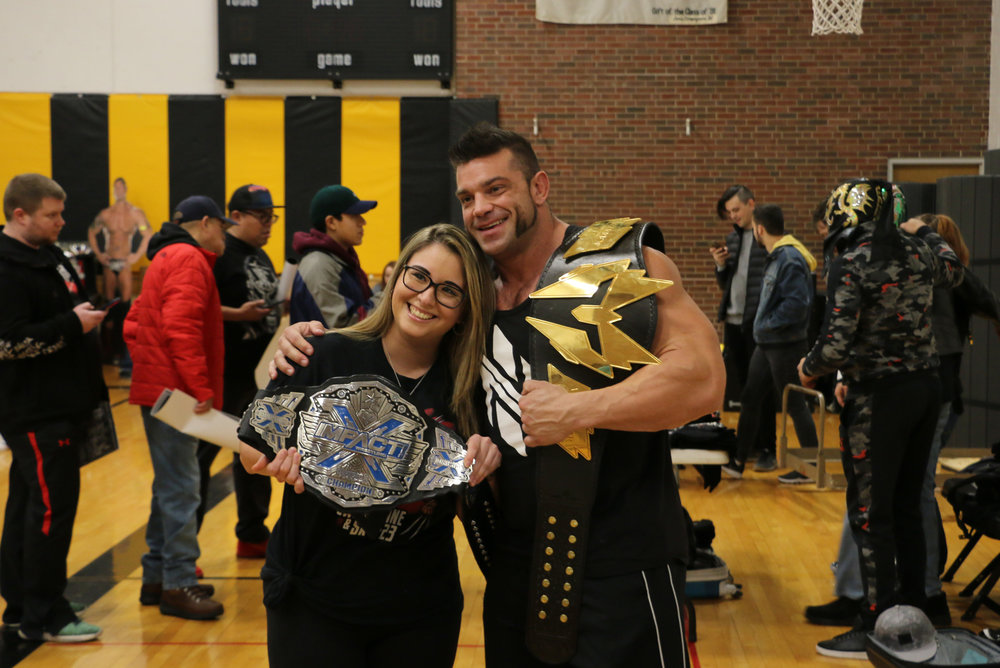 Warrior Wrestling Champion Brian Cage poses with a fan at the VIP Fan Fest.