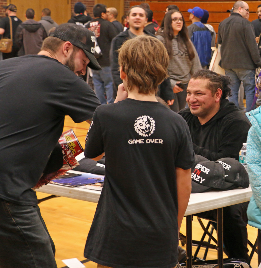 Former ECW and WWE superstar Super Crazy talks with fans at the VIP Fan Fest.