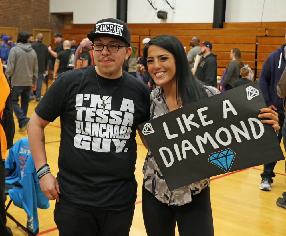 Tessa Blanchard poses with a fan and his custom-made sign at the VIP Fan Fest.