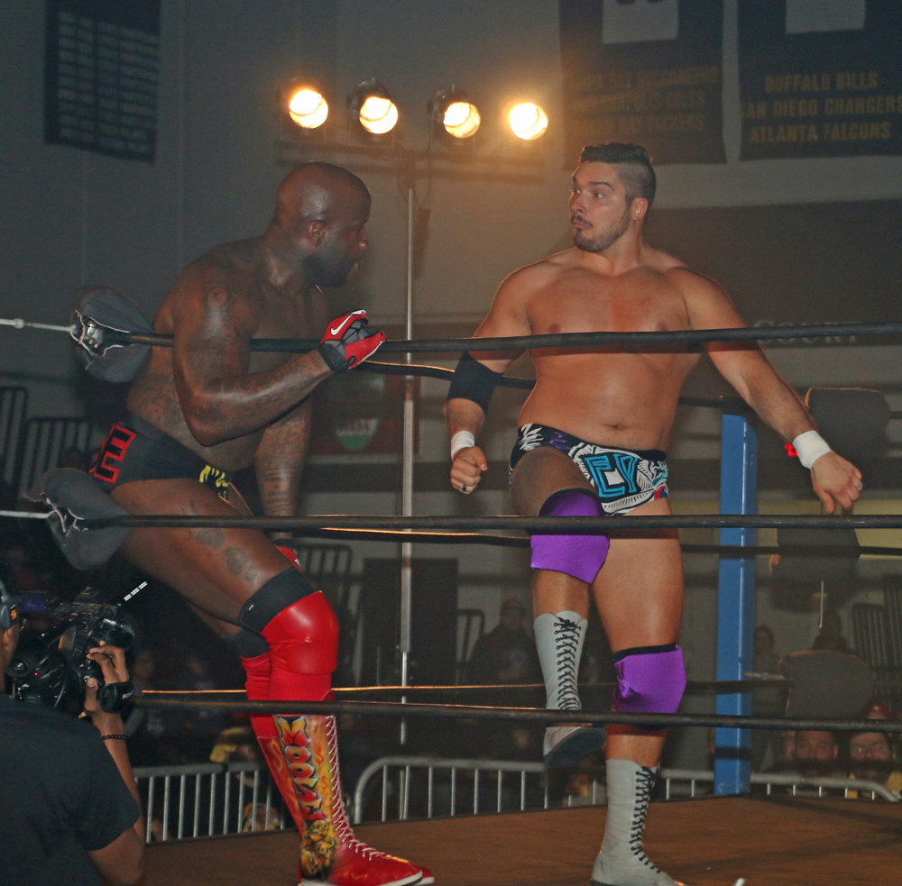 Ethan Page, right, prepares to deliver a right hand to Moose in the corner.