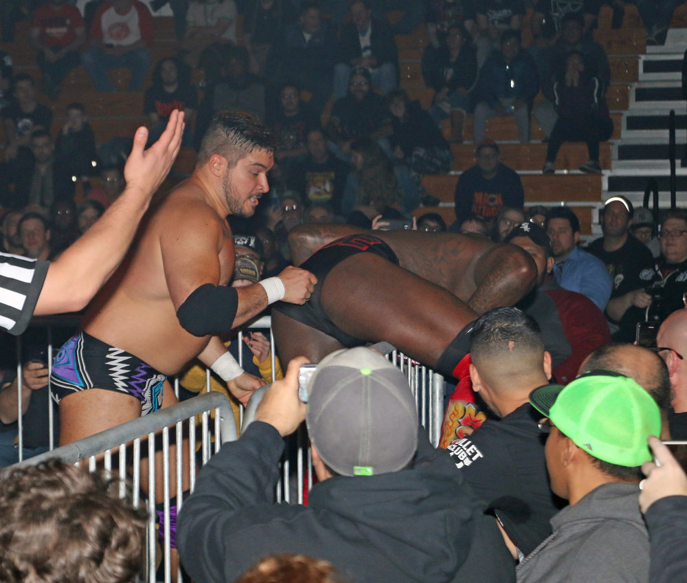 Ethan Page dumps Moose into the crowd.
