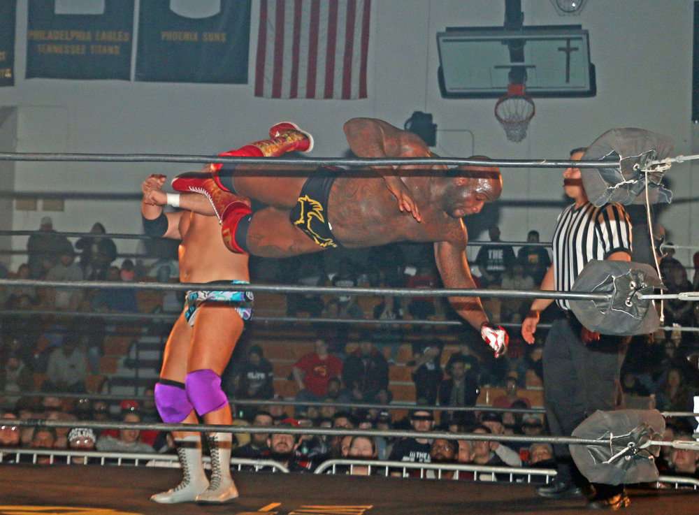 Moose hits the dropkick on Ethan Page.