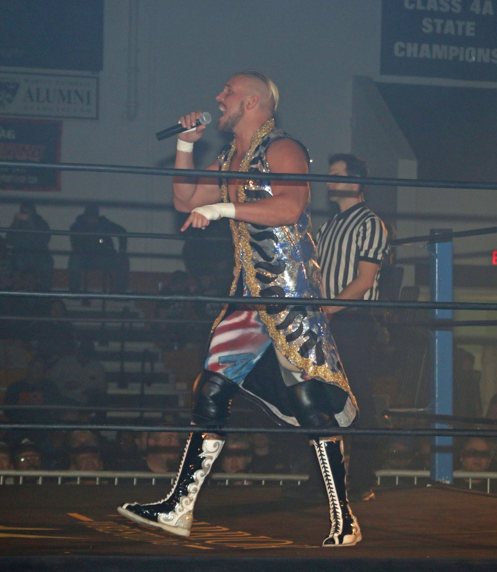 Sam Adonis addresses the Warrior Wrestling crowd before the trios match.