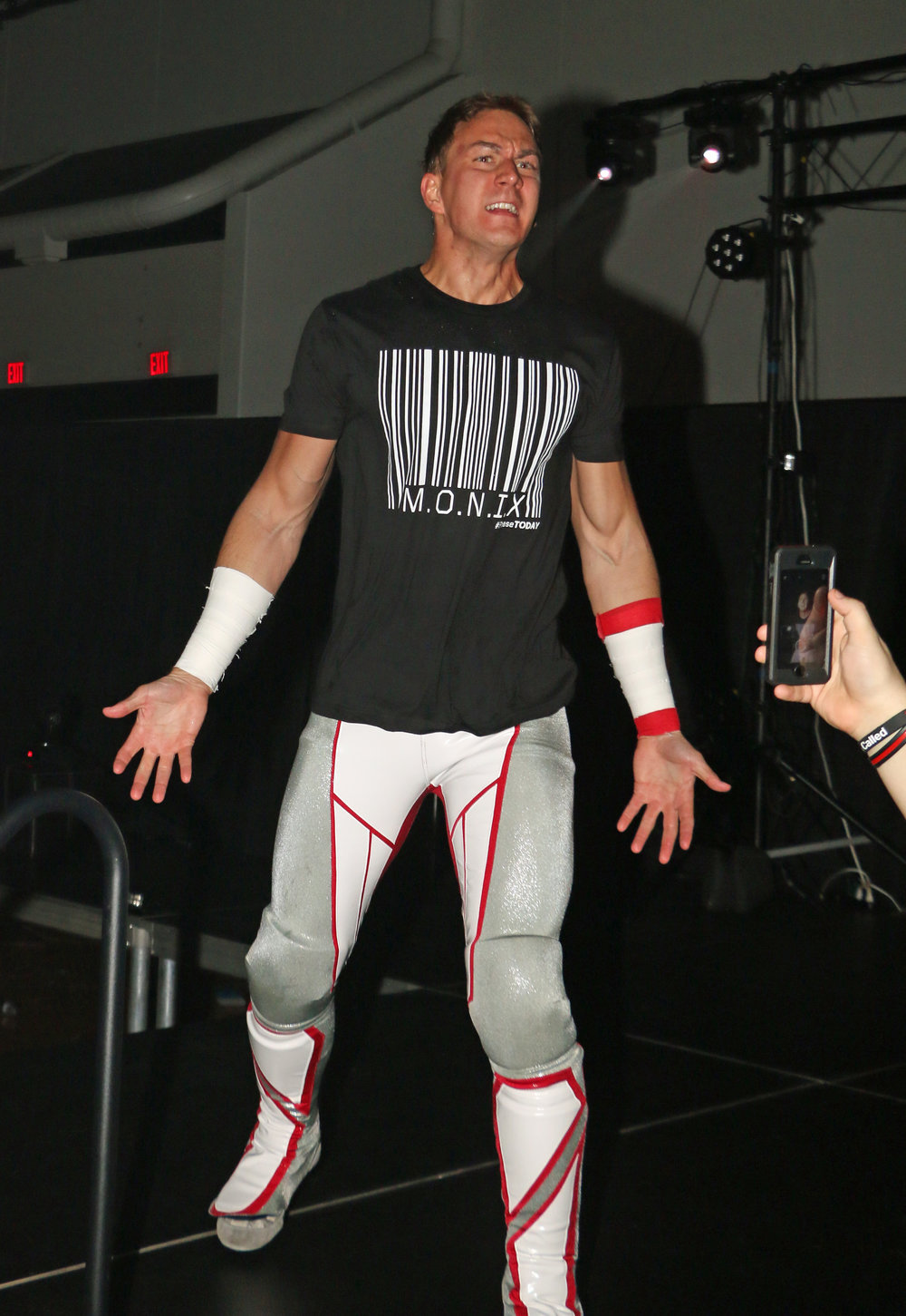 Chicago's Pat Monix enters the arena before the Lucha Libre trios match against Sam Adonis' team.