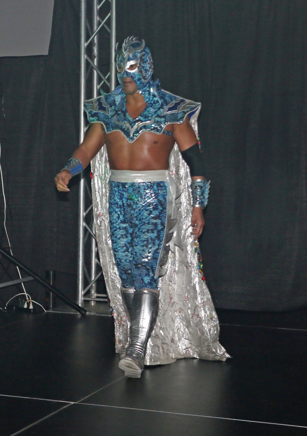WCW and WWE legend Ultimo Dragon walks down the ramp before the trios match.