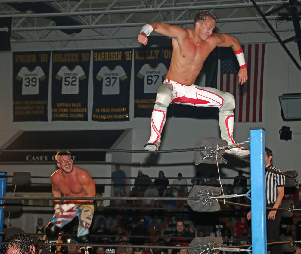 Pat Monix, right, looks to leap off the top rope onto Sam Adonis.