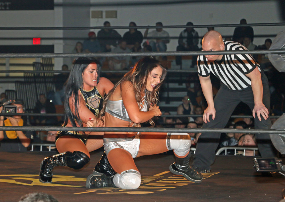 Tessa Blanchard controls the arm of Britt Baker.