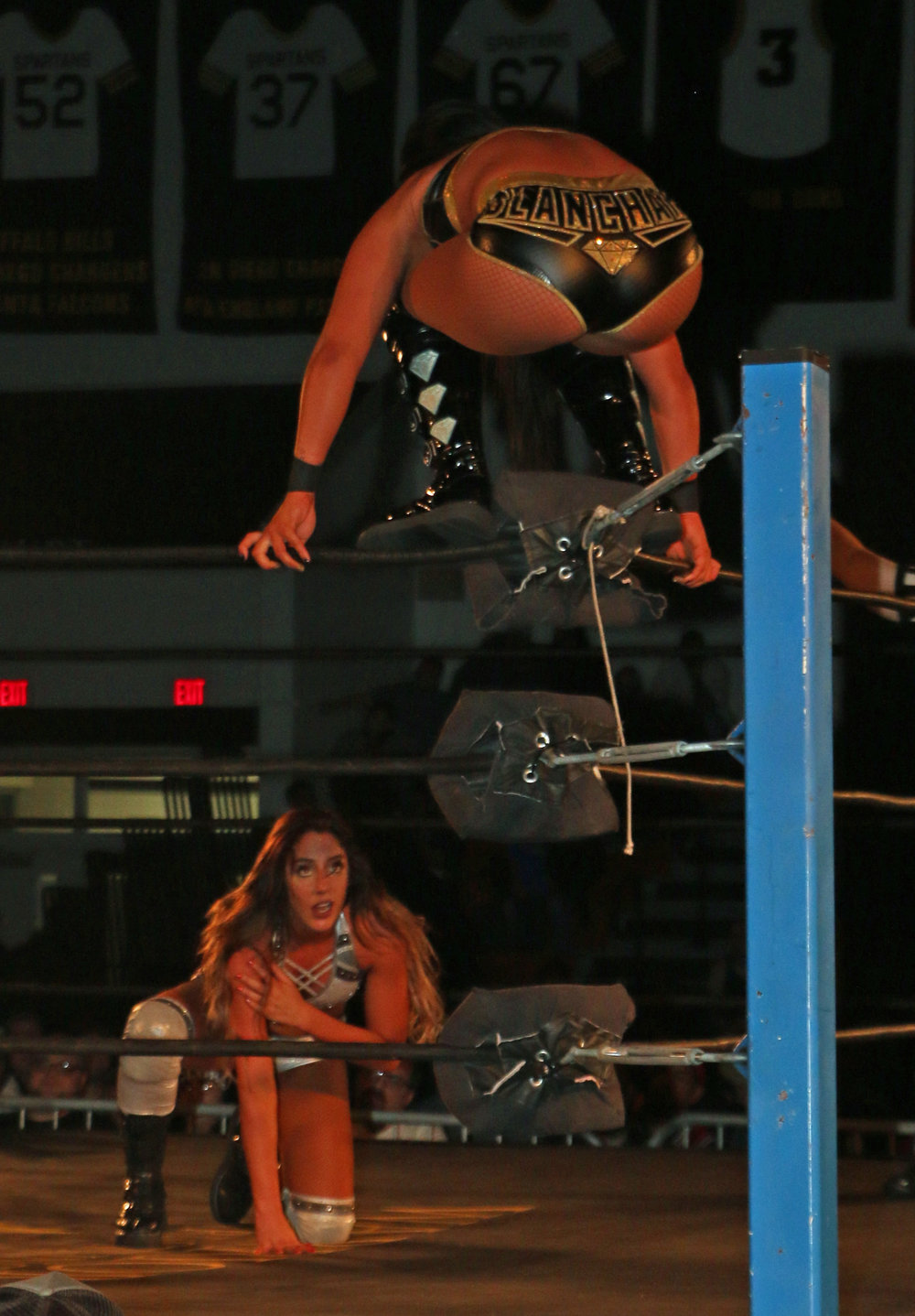 Tessa Blanchard looks to jump off the top rope as Britt Baker fights to get back on her feet.