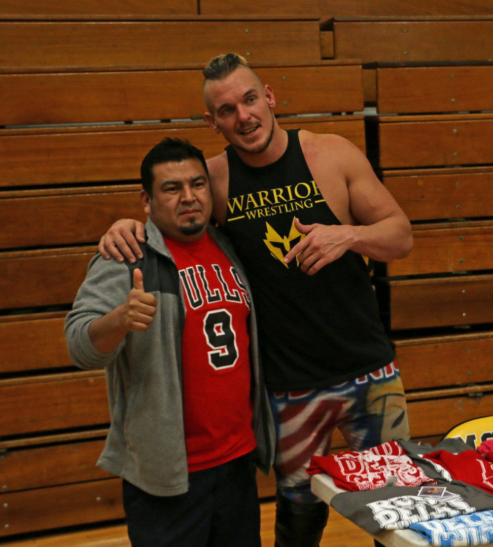 Sam Adonis poses with a fan at the intermission meet and greet.