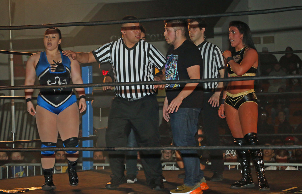 Officials get in between Jordynne Grace, left, and Tessa Blanchard.