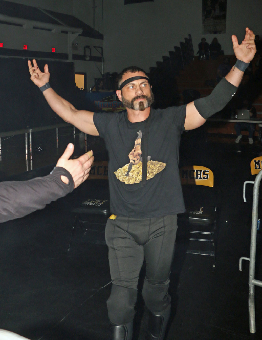 Austin Aries enters the arena for his match against Eddie Edwards.