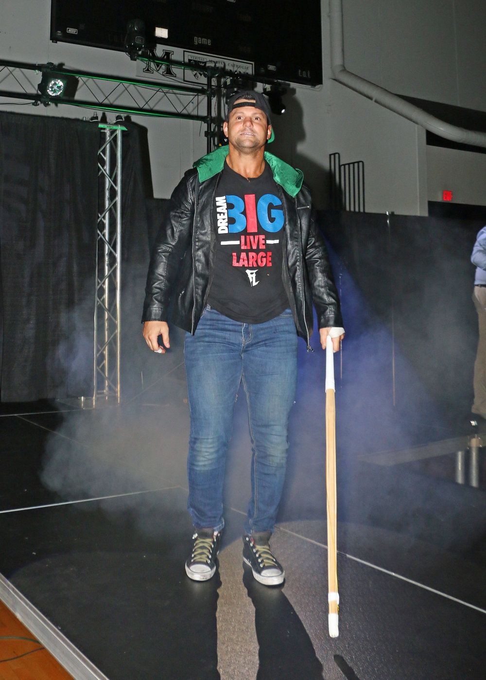 Eddie Edwards, with kendo stick in hand, prepares to walk down the ramp for his street fight against Austin Aries.