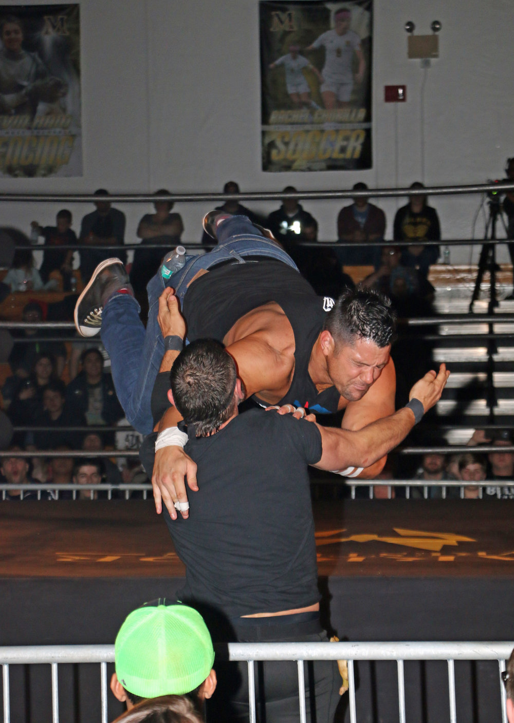 Eddie Edwards performs a suicide dive through the ropes onto Austin Aries during their street fight.