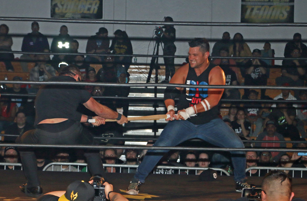 Austin Aries, left, and Eddie Edwards battle for the kendo stick.