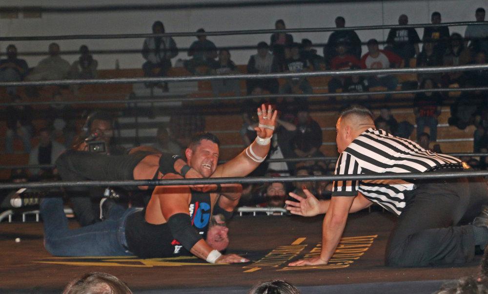 Austin Aries applies the Last Chancery to Eddie Edwards.