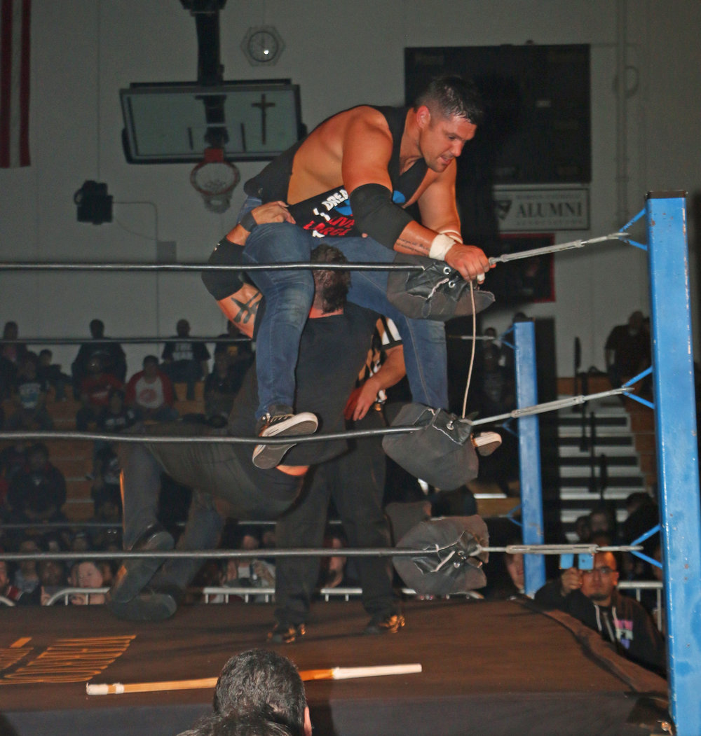 Austin Aries prepares to deliver a powerbomb to Eddie Edwards.