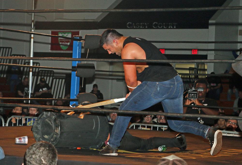 Eddie Edwards unleashes a kendo stick shot on Austin Aries.