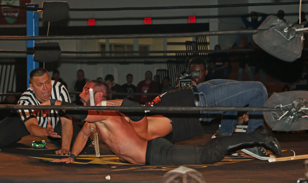 Eddie Edwards uses the Last Chancery on Austin Aries, and the help of the kendo stick, got the tapout victory.
