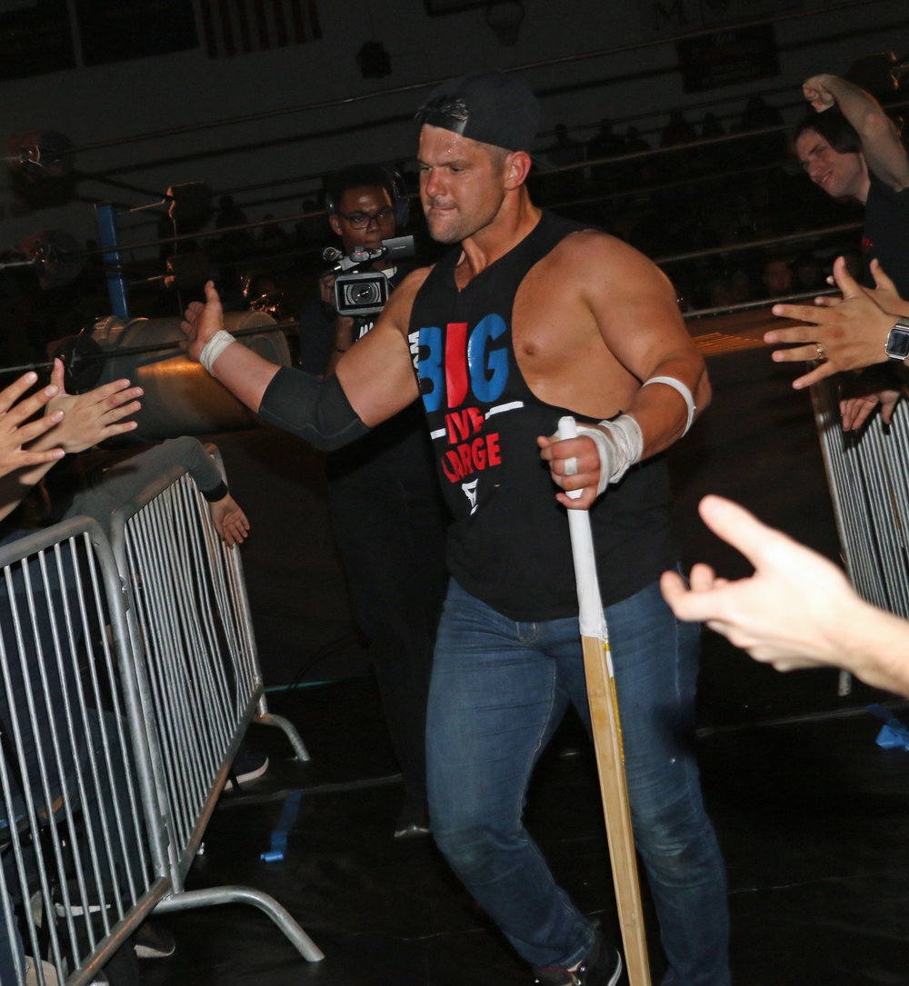 Eddie Edwards slaps hands with fans following his win over Austin Aries.
