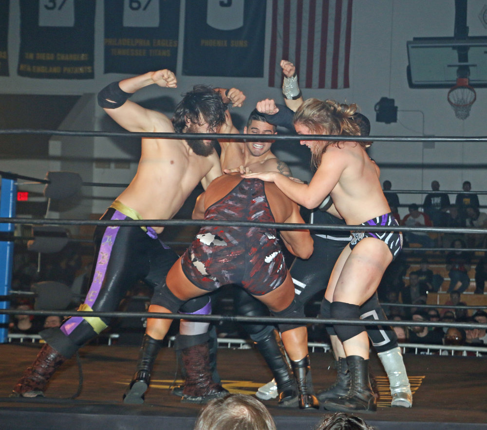 Several competitors attack Wardlow during the Freelance Free-For-All match.