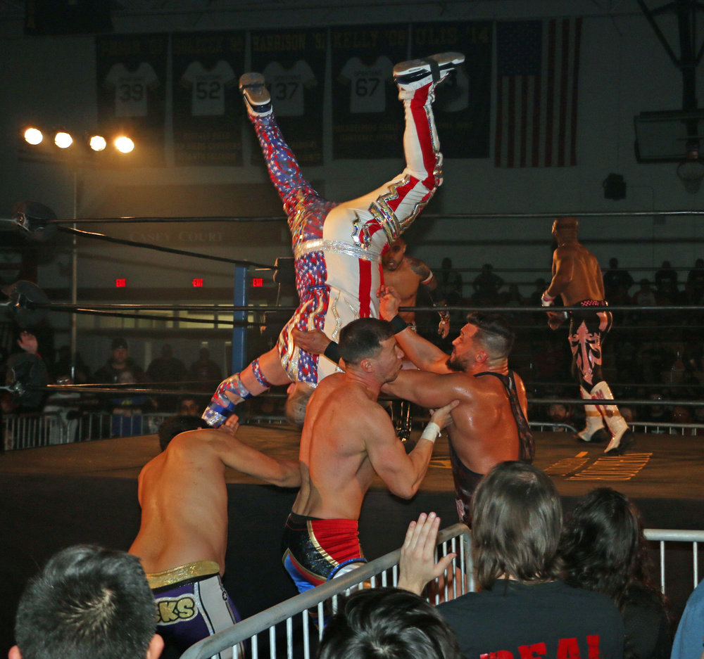 Gringo Loco dives onto several opponents at ringside during the Freelance Free-For-All match.