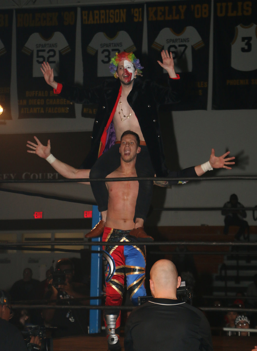 "Robert ""Ego"" Anthony and Frank the Clown celebrate Anthony's final pinfall on Brian Pillman Jr. and the victory in the Freelance Free-For-All match."