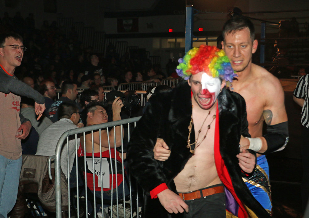 "Frank the Clown and Robert ""Ego"" Anthony get out of the dodge after Anthony's victory."