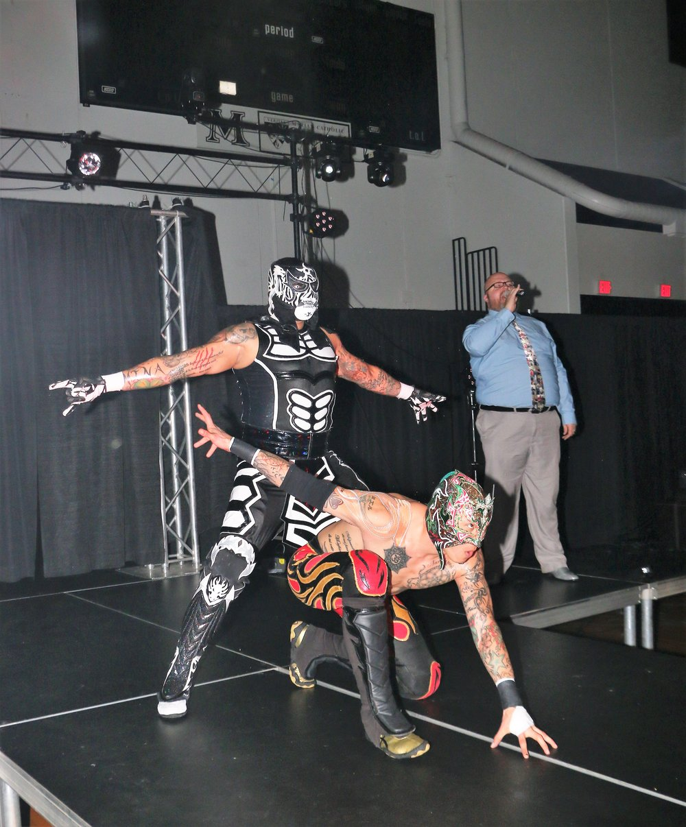 Penta El 0M, left, and Fenix, make their entrance before their tag team match against Team White Wolf.
