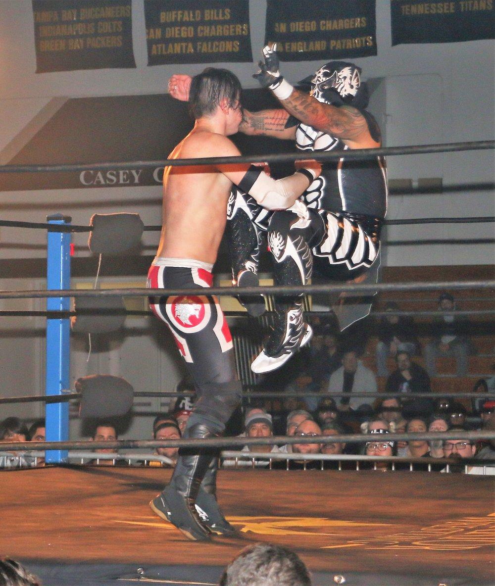 Penta El 0M hits the codebreaker on Carlos Romo.