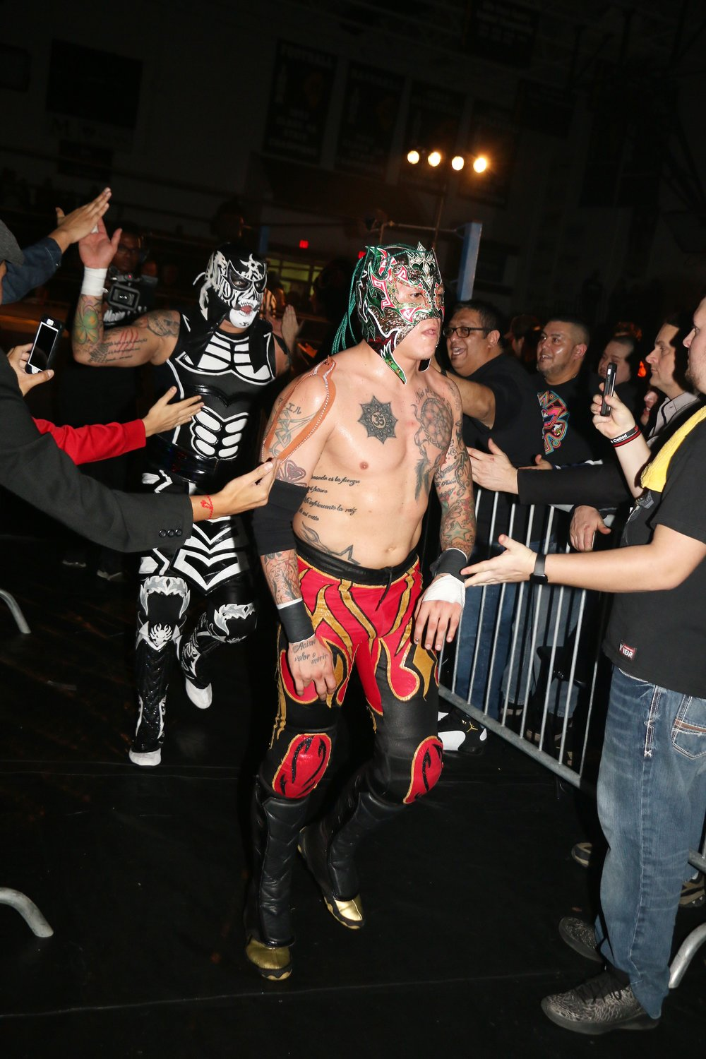 Fans greet the Lucha Bros. after their tag team victory.