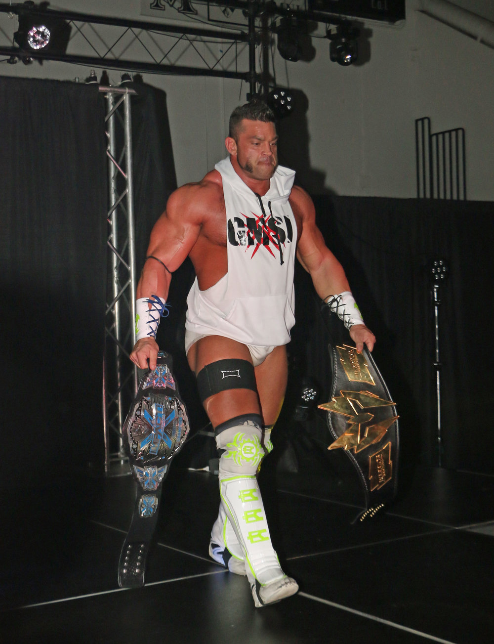 Warrior Wrestling Champion Brian Cage comes out with both the WW title and the IMPACT X Division Championship.