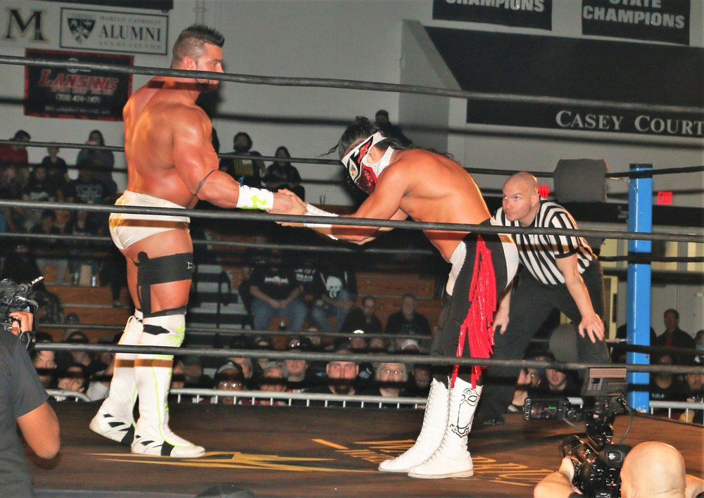 Warrior Wrestling Champion Brian Cage, left, and Bandido share a sign of respect before their main event match.